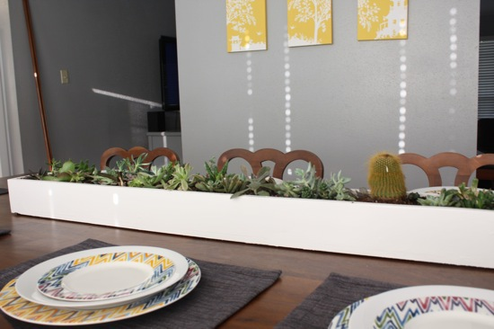 Gorgeous, simple DIY succulent planter. This planter is easy to build and it makes a huge impact! It will look perfect sitting on your dining room table, and you can adapt it to fit pretty much anywhere in your home!