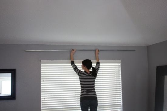 Installing a DIY conduit curtain rod