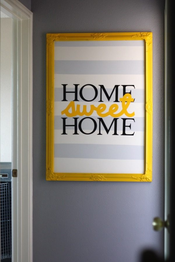 How to take an old thrift store frame and turn it into gorgeous vinyl artwork! This project is so simple but it makes a huge impact!