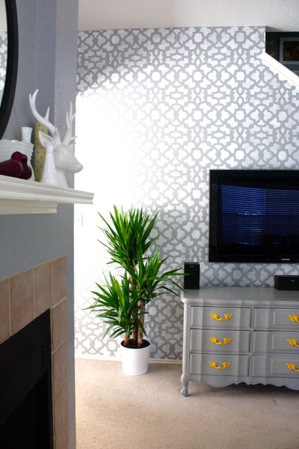 Have a boring wall in your house that needs a bit of life? Here's how to use a stencil to create a show-stopping accent wall that EVERYONE will ask you about when they visit your house! It's so much simpler than it looks!
