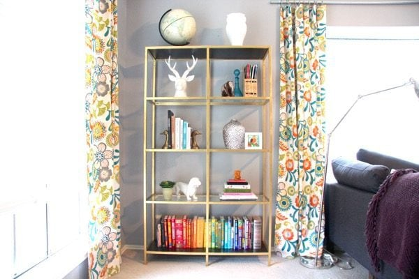 How to take a plain ol' IKEA VITTSJO bookcase and turn it into something spectacular with a little bit of gold paint!