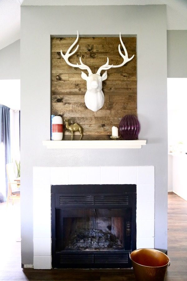 This wood-paneled fireplace was created under an hour for about $30! The transformation is incredible, and this project is so easy! You can use this tutorial to make a plank wall anywhere you want!