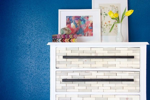 You won't even believe how simple and affordable it is to make this gorgeous West Elm-inspired DIY wood-tiled dresser. The tutorial is incredibly thorough, and the end result is absolutely stunning!