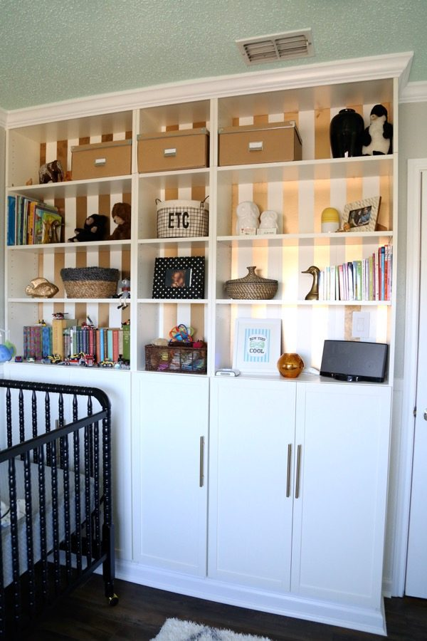 This nursery is simple, calming, and absolutely gorgeous. The art above the crib may be the best part of the whole room! The DIY built-in Billy bookcases are a close second!