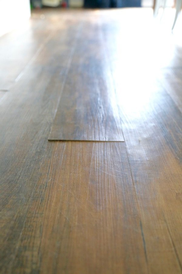 Can you believe that flooring is vinyl plank flooring? And that it cost under $2 per square foot? Here's a thorough review of Lowe's Style Selections luxury vinyl plank flooring, after living with it for more than 2 years