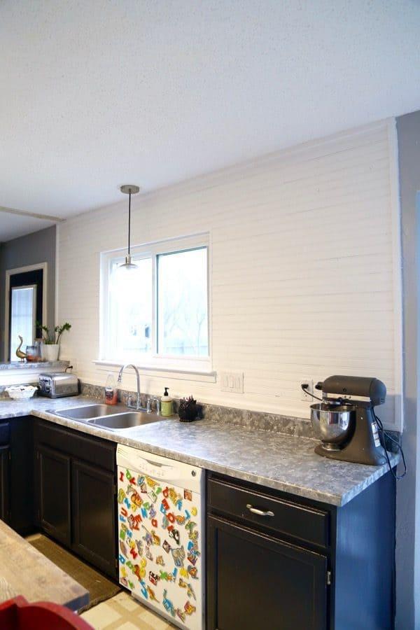 Completed beadboard backsplash in kitchen