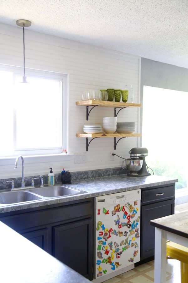 Love the look of open shelving in your kitchen but have no idea how to tackle it? This tutorial will help you out - it's incredible simple, and it looks gorgeous! As an added bonus, it only costs about $50 for the entire project!