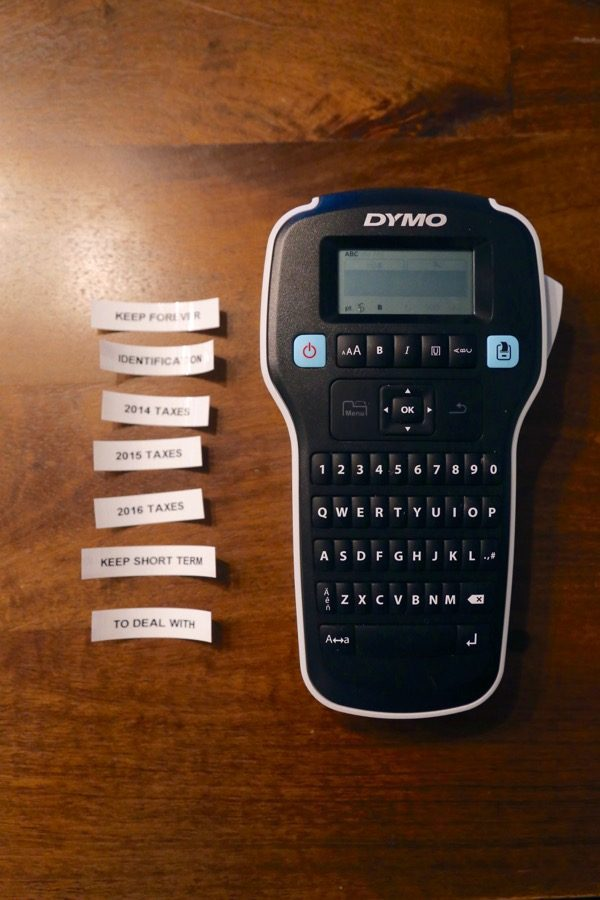 Label maker with various labels on a table