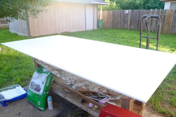 A plywood board primed and ready to be painted with chalkboard paint