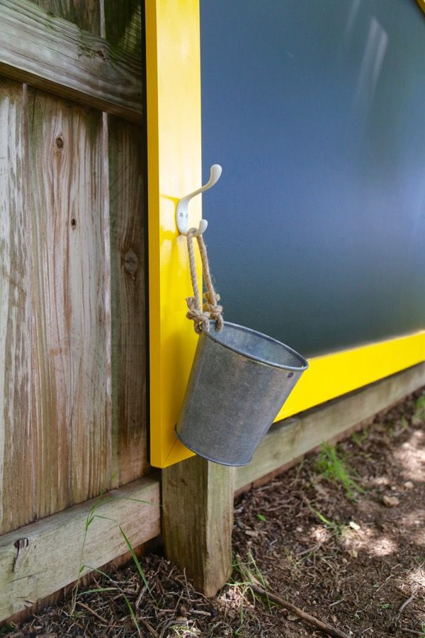 closet up of hook and bucket to hold chalk