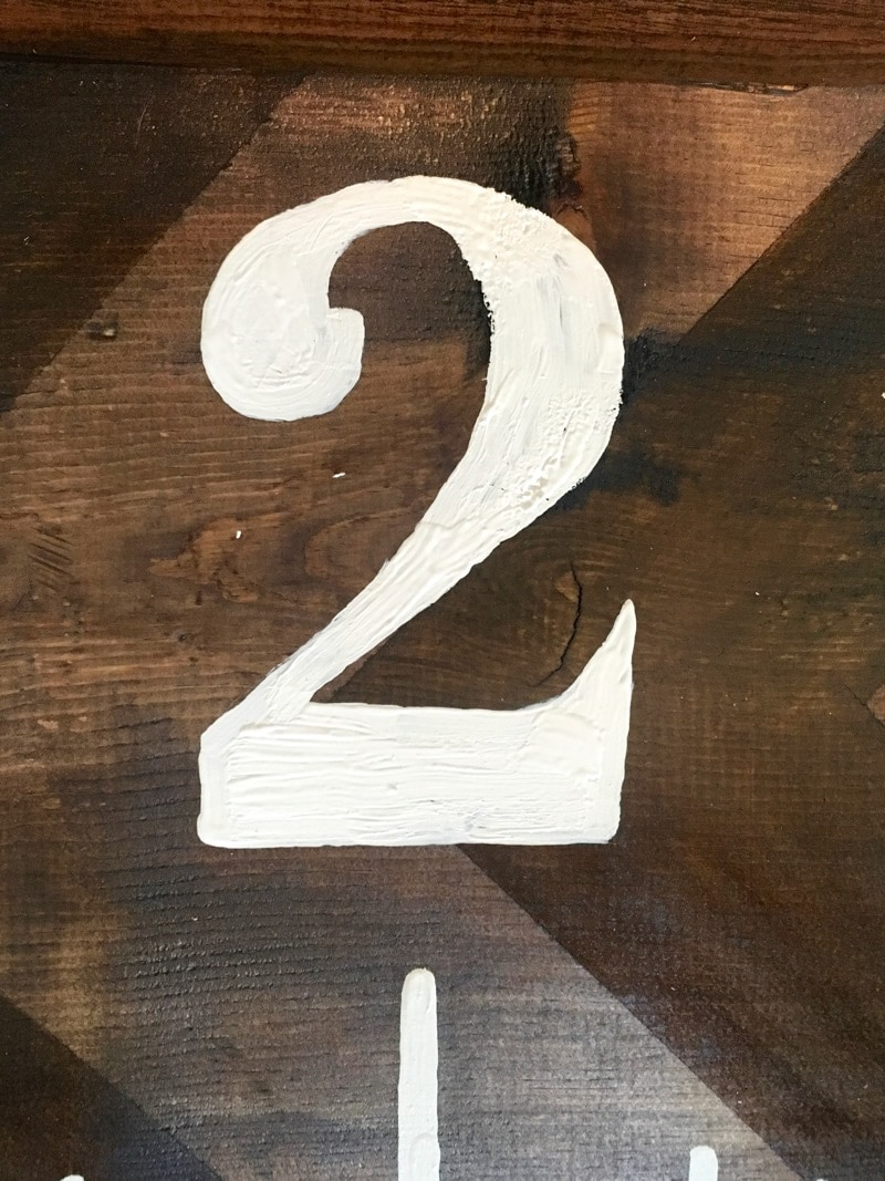 painting numbers on wooden growth chart ruler