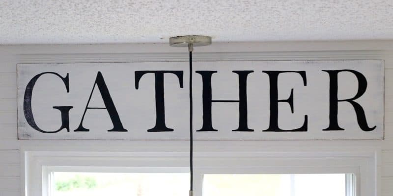 This vintage-style kitchen sign is gorgeous and so easy to make! It looks like something that might be in a Fixer Upper farmhouse kitchen, and it'll only cost you about $20 to make yourself.