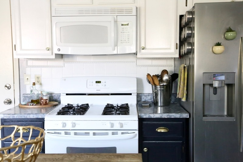 I love this gold hardware! It's amazing what a simple little update can to do totally transform a room. And can you believe those countertops are painted?!