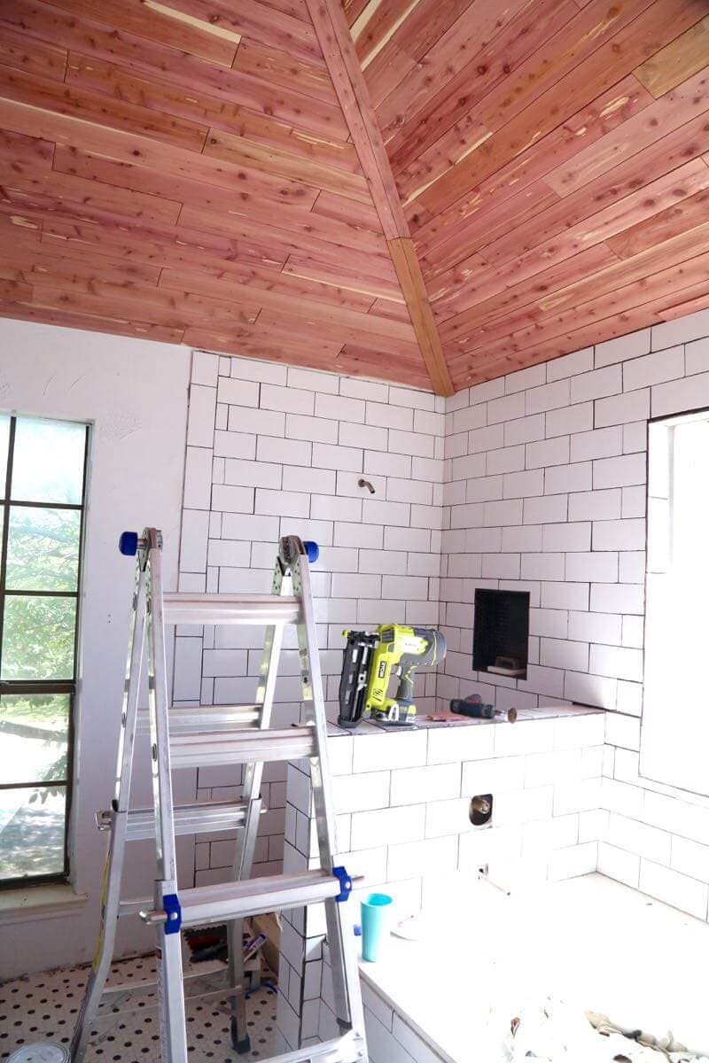 This bathroom is amazing! I never would have thought to cedar plank a ceiling, but this looks incredible. This post teaches you how to do it (it's SO EASY!), and it would look great in any room!