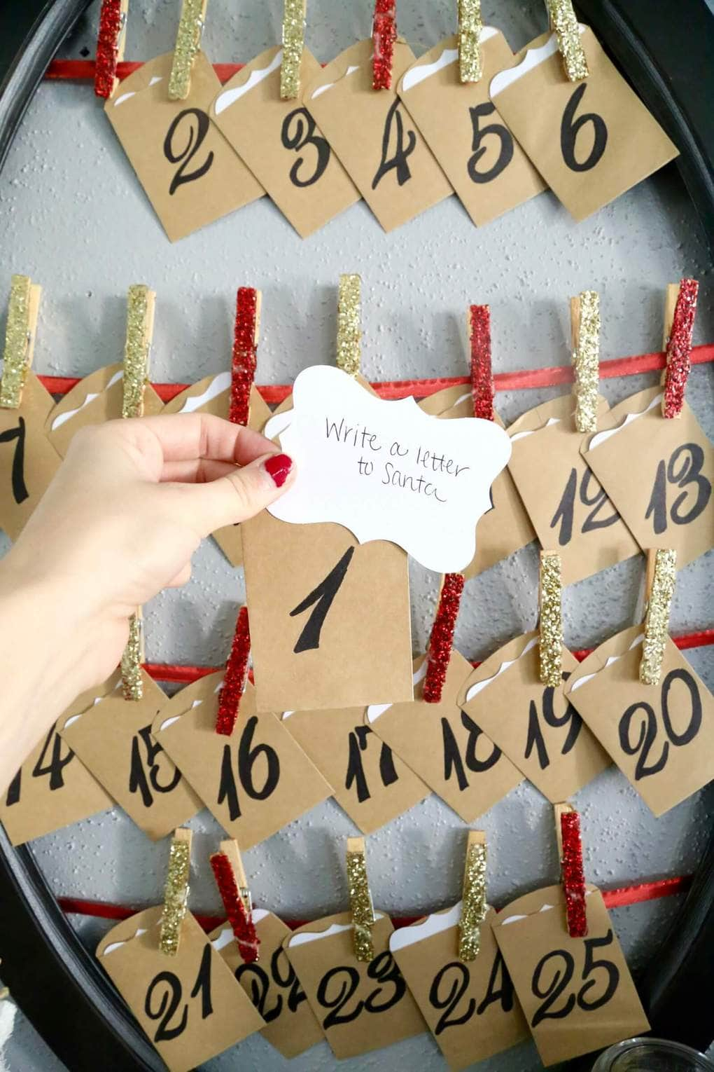 This DIY activity advent calendar is a great Christmas tradition. Tons of great ideas for activities to do with your family this Christmas, and it's so simple to make yourself!