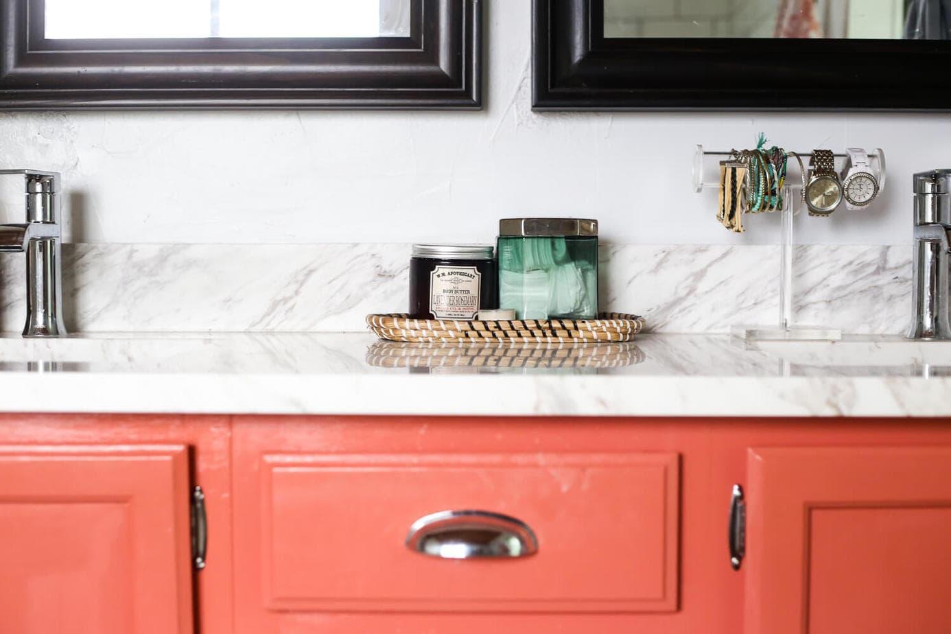 Close-up of coral vanity with quartz countertop.