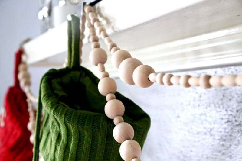 How to make a simple DIY wood bead garland. Perfect for your mantle at Christmas. This thing is so gorgeous, and so easy to make!