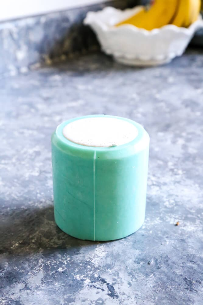 Concrete mix drying in a candle holder mold