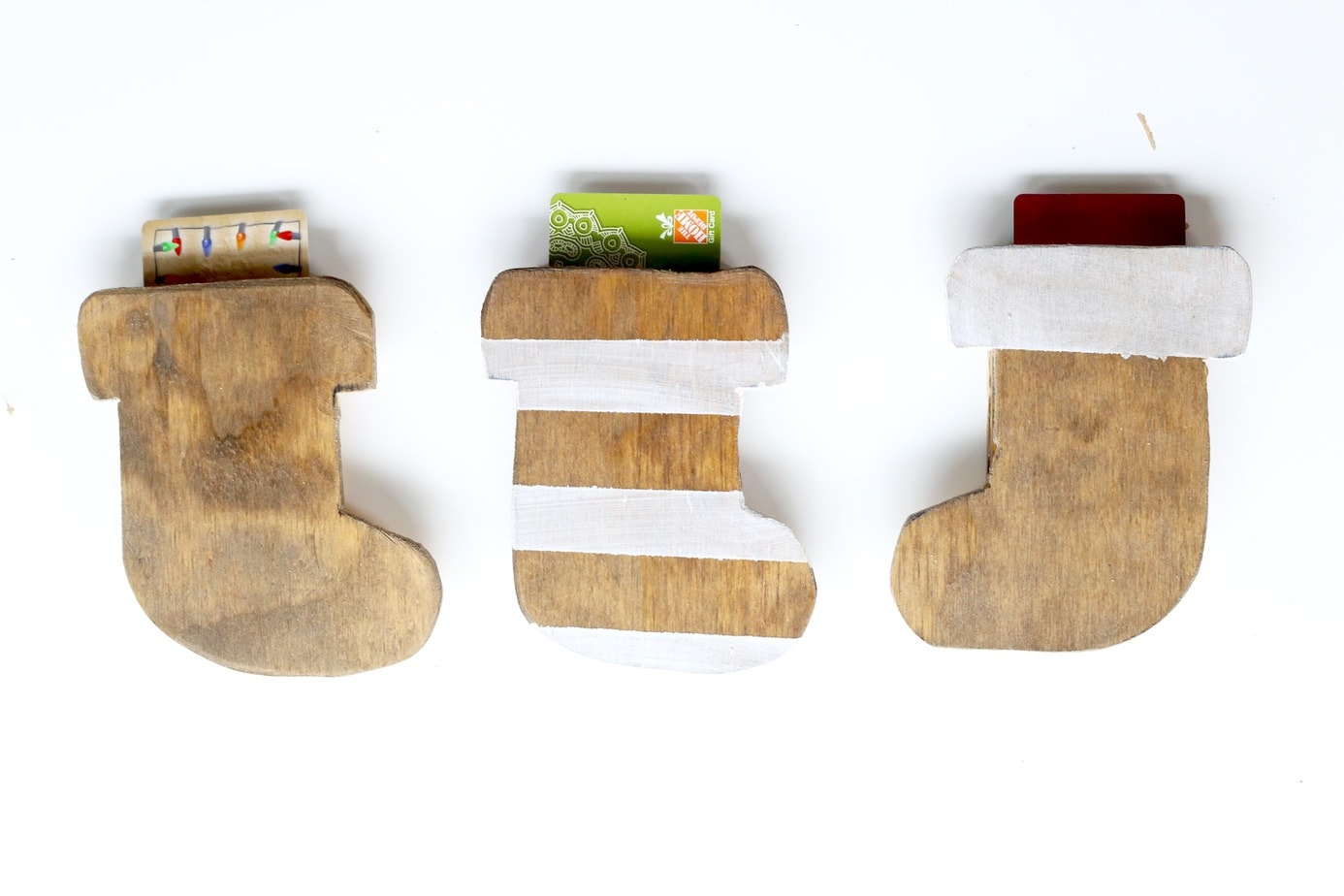 Need a unique and creative way to give a gift card? These wooden stocking gift card holders are so cute and so simple to make! This is the perfect gift idea for anyone on your list.