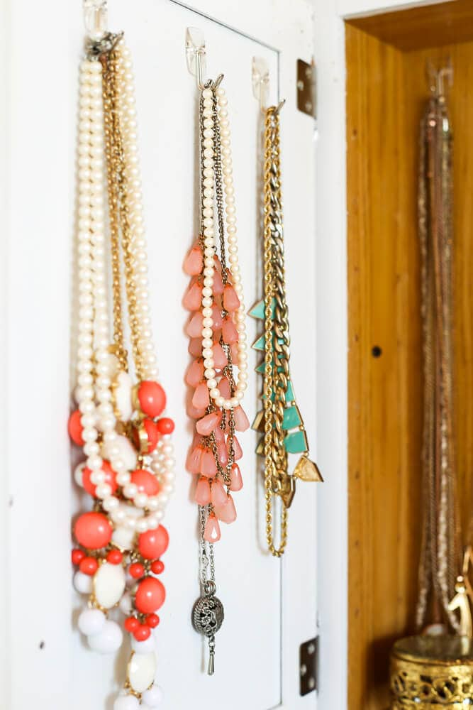 DIY necklace holder in a medicine cabinet
