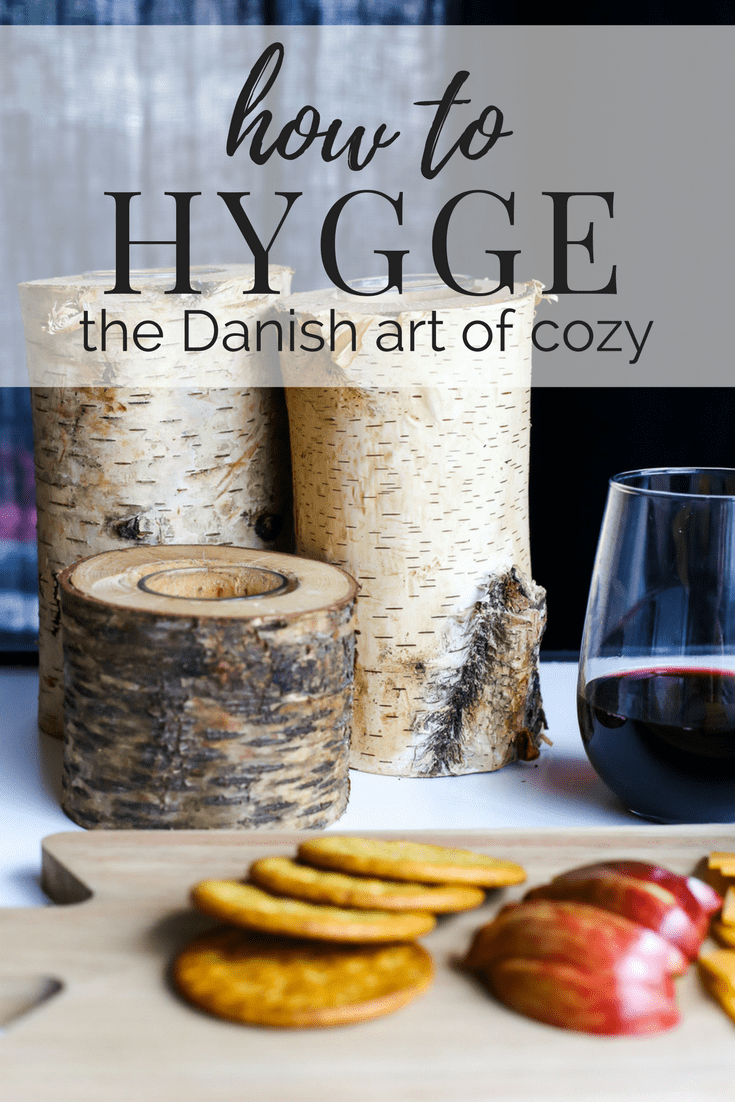 A cozy setup with fruits, candles, and wine - all about how to hygge