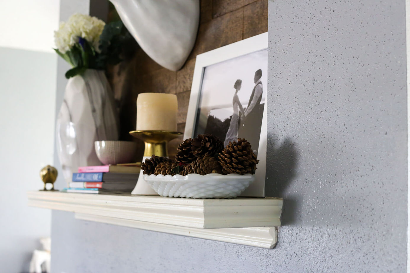 A bright winter mantel for when you feel like you're ready for spring. All it takes to make the room feel refreshed is to add a little color and depth to your decor - a little goes a long way!