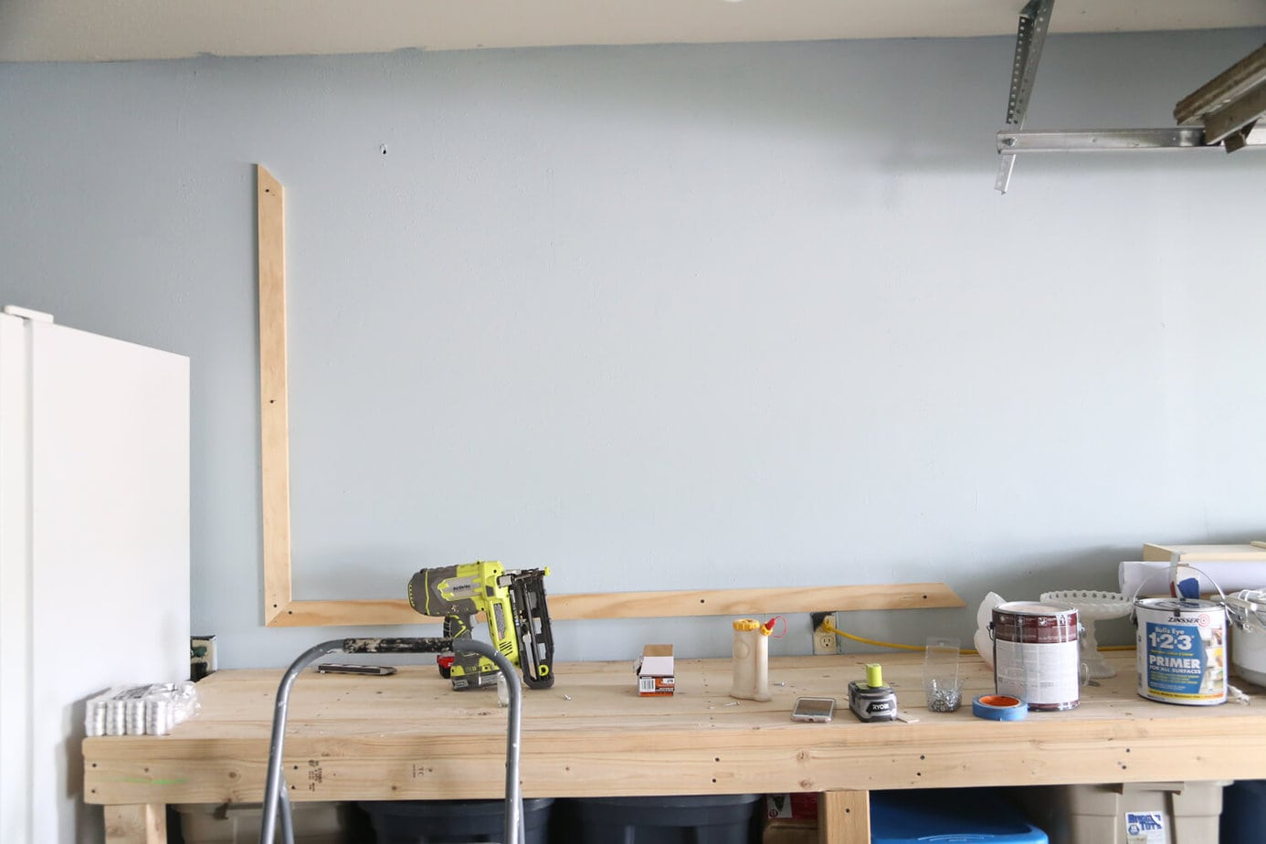 How to create a large-scale chalkboard on a wall in your home, along with a simple DIY wood frame!