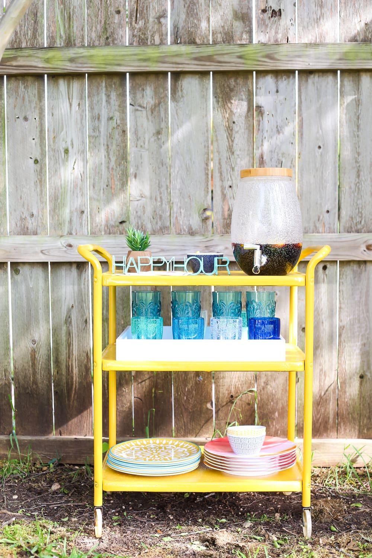 Rusty furniture makeover for a backyard bar cart