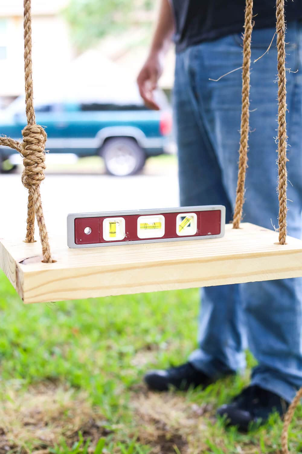 How to build a quick and simple wood tree swing for young kids - it costs about $10 and takes less than an hour to put together! Easy, affordable ideas for outdoor play.