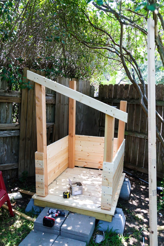 Diy playhouse how to build a backyard playhouse for your for Easy to build playhouse