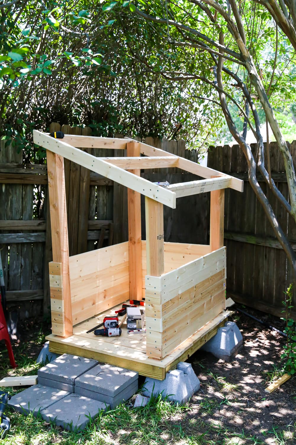 Easy diy backyard playhouse love renovations for How to make a playhouse out of wood