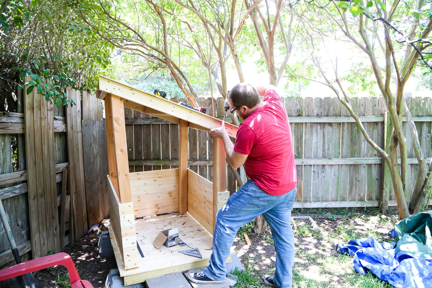Diy playhouse how to build a backyard playhouse for your for How to make a playhouse out of wood