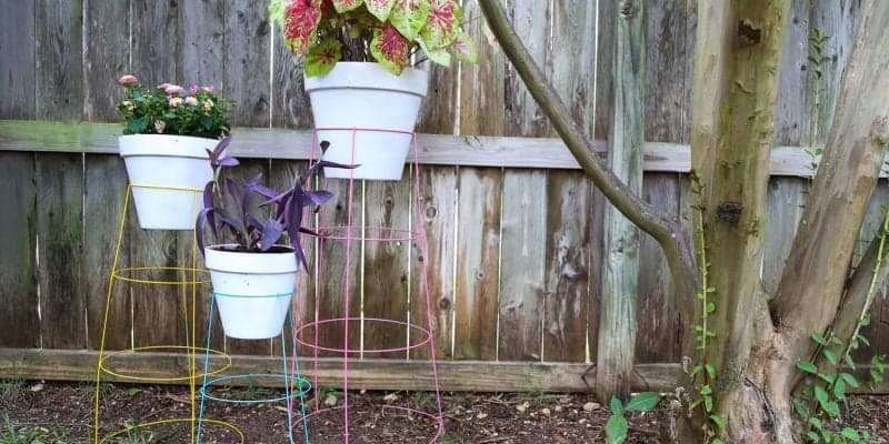 How to make DIY plant stands from tomato cages in just 15 minutes for less than $20. They're so easy, colorful, and fun and they're a great way to display your favorite plants!