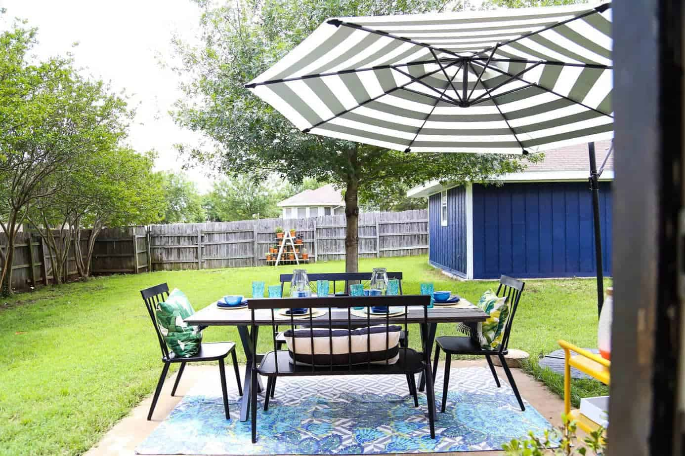 This patio is so gorgeous and cozy - and everything out here is so affordable! There are some great ideas for making a small patio feel spacious, and tips for choosing outdoor furniture.