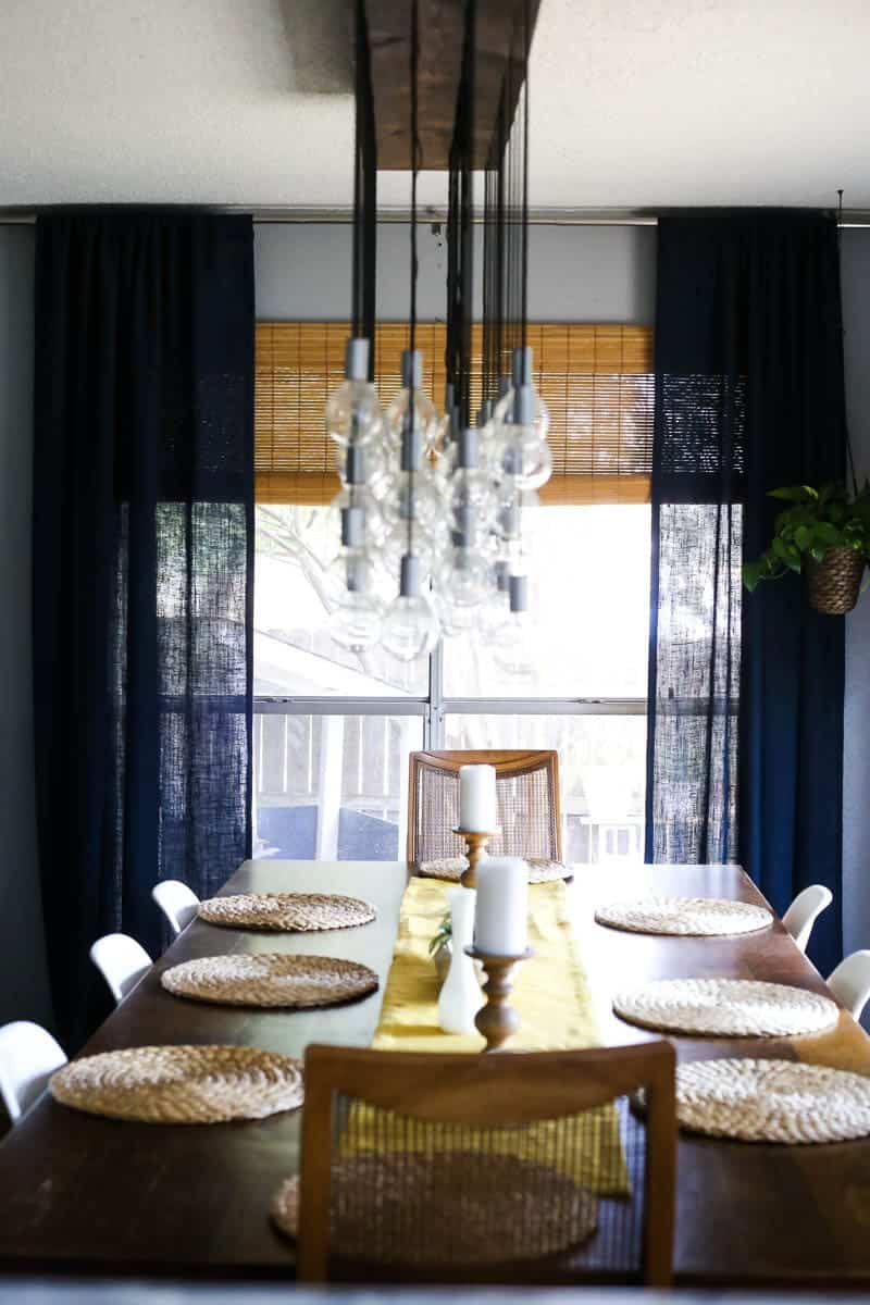 This dining room chandelier is a DIY project! It's so gorgeous, and actually really easy to make!