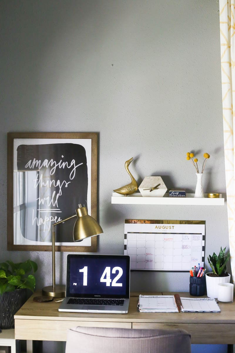 A simple, organized, and beautiful desk area with an organized family command center
