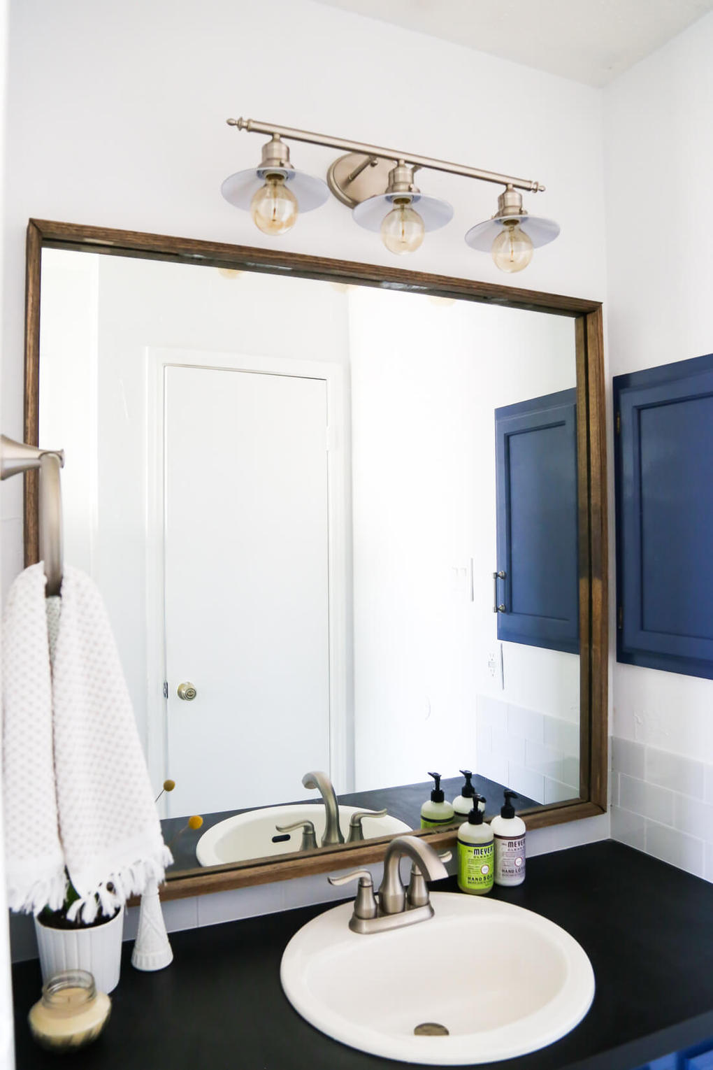 Framing Our Bathroom Mirror | Love & Renovations