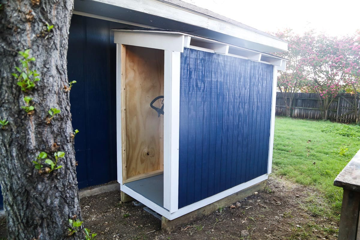 Diy lawn mower shed quick and easy diy love renovations for Lawn mower shed