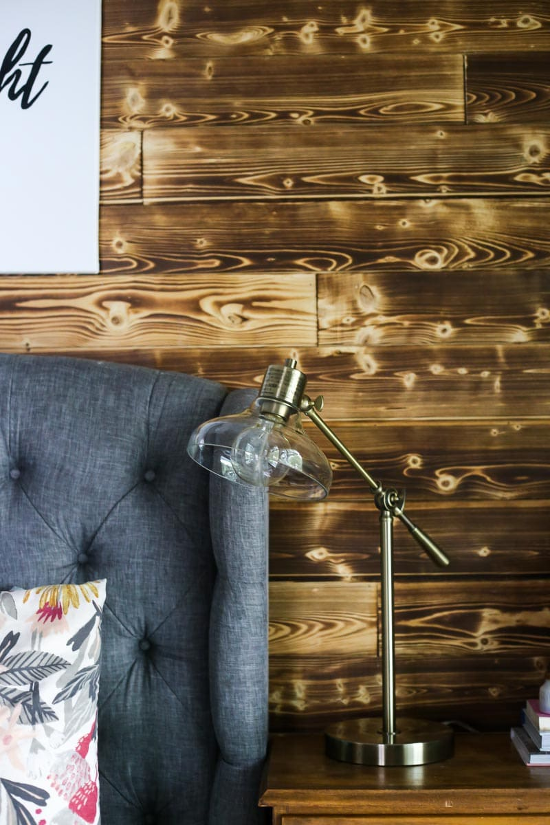 A beautiful DIY wood planked accent wall made with Home Depot's appearance boards