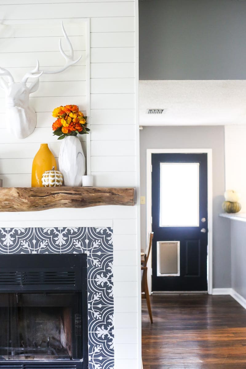 How to build a DIY wood mantel using an old tree - this rustic mantel is perfect for your fireplace