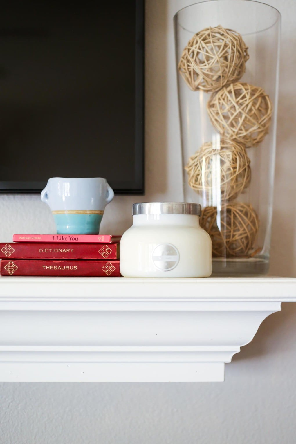 Tips for decorating a mantel with a television