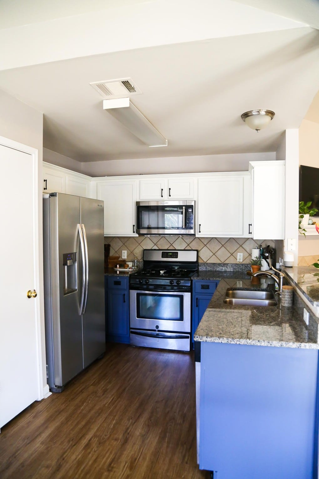 Tips and tricks for painting kitchen cabinets - the best paint colors to use the & Our DIY Blue \u0026 White Kitchen Cabinets - Love \u0026 Renovations