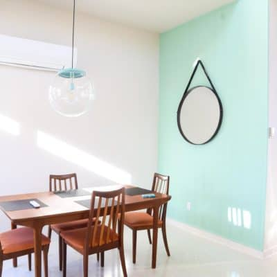 Gorgeous mid-century modern dining room with blue paneling - designed by Starlight Village Homes