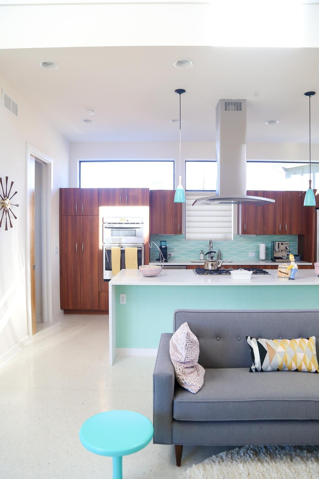 A mid-century modern living room and kitchen designed by Starlight Village in Leander