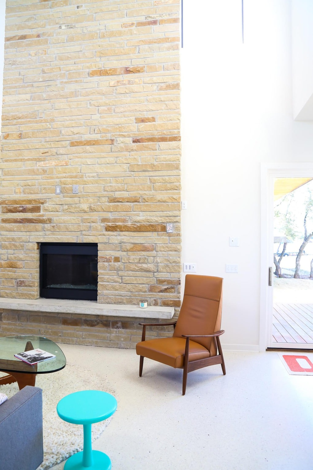 Stone fireplace - gorgeous midcentury modern homes in Starlight Village in Austin