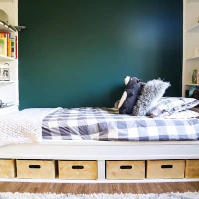 White built in bedding and shelves with gray buffalo check bedding