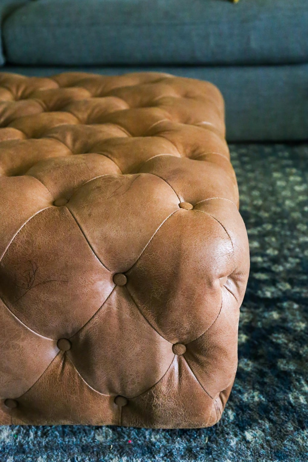 Close-up of leather ottoman after cleaning