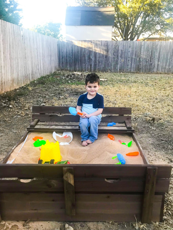 Backyard sand box with bench