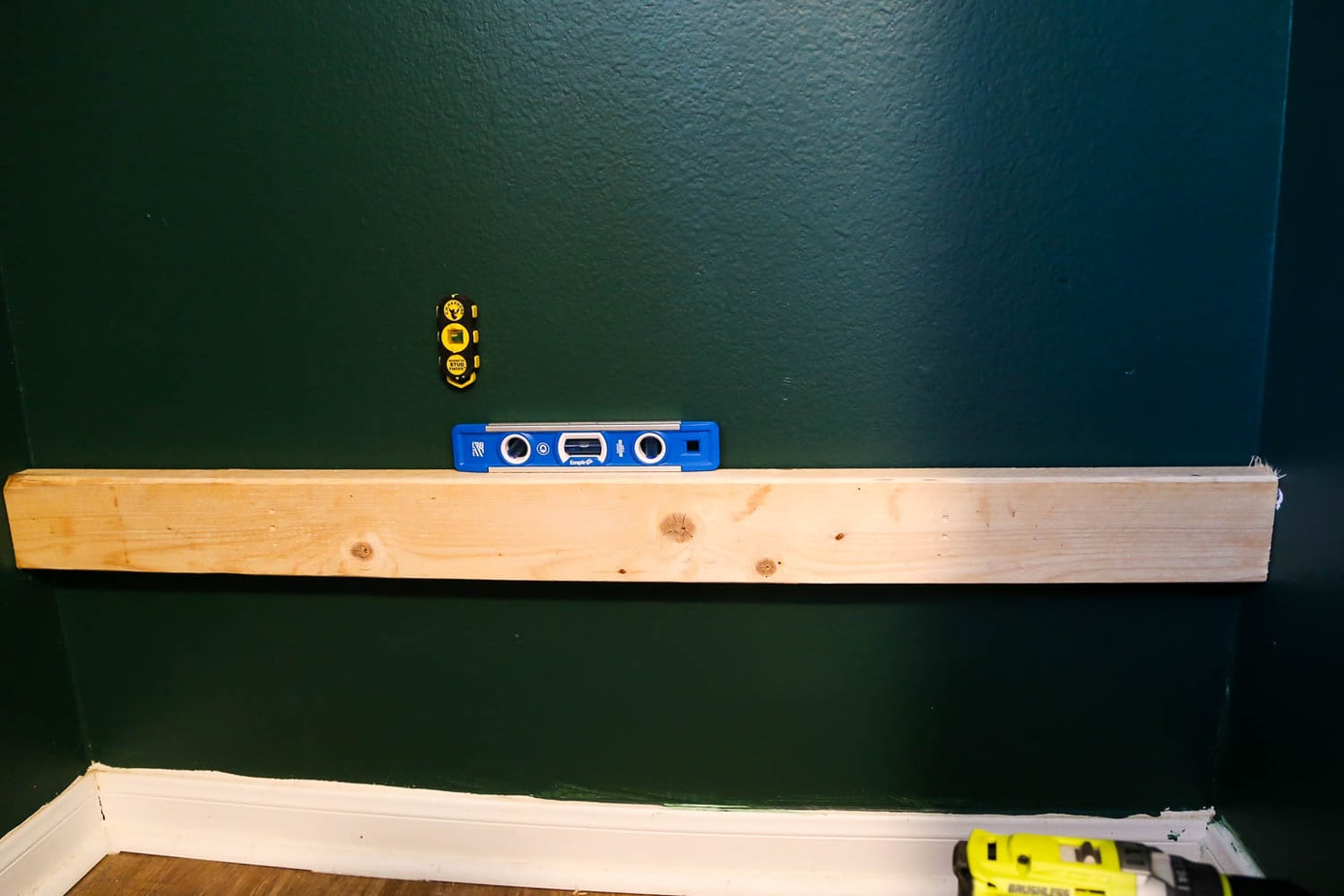 installing support boards for DIY closet shelves