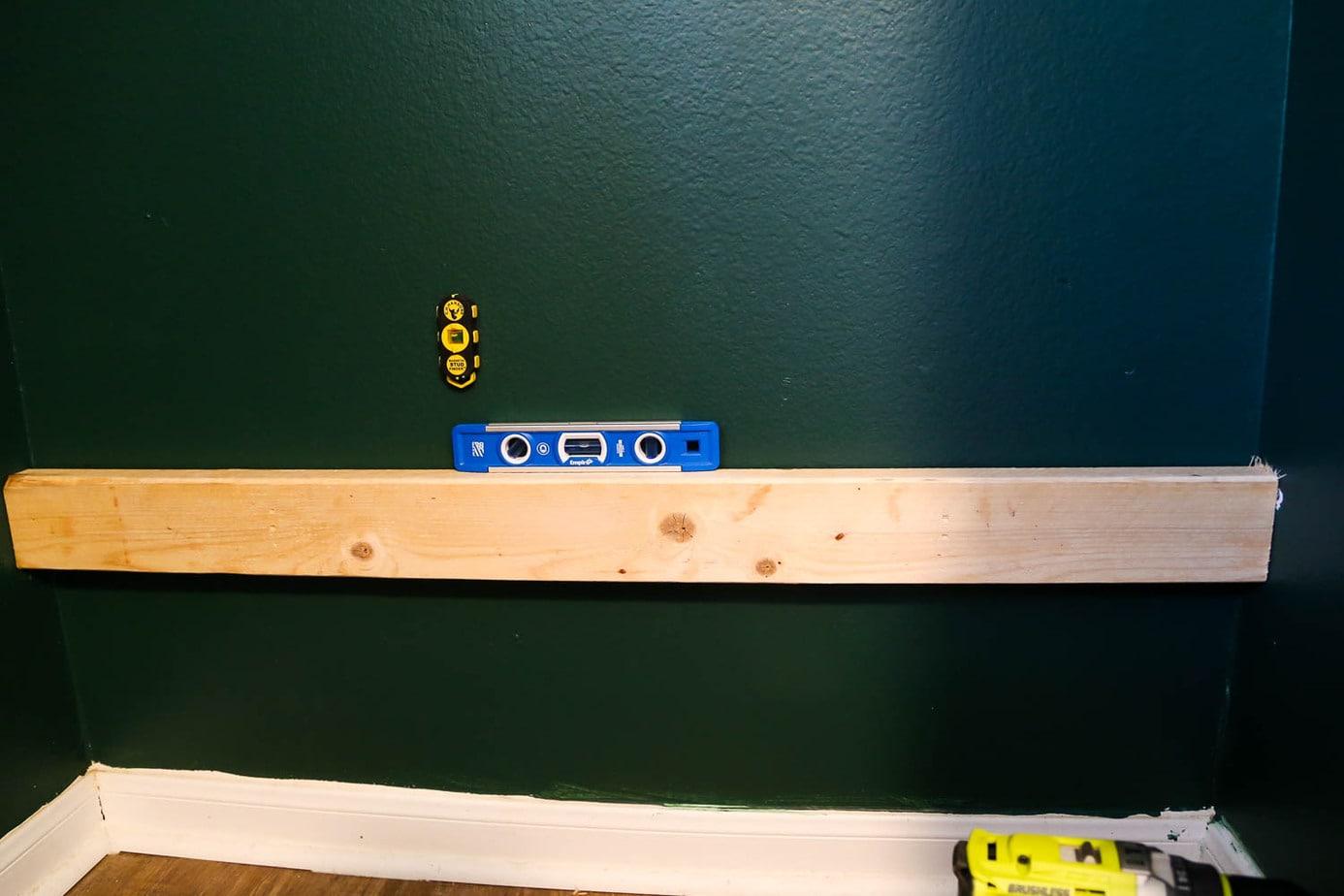 installing support boards for DIY closet shelves